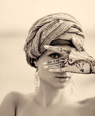 I love this picture! The henna on her hands is gorgeous.