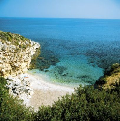 Skala, Kefalonia, Greece. The hidden beach where one romantic scene and one not-so-romantic scene takes place in Package Deal by Tasha Harrison.
