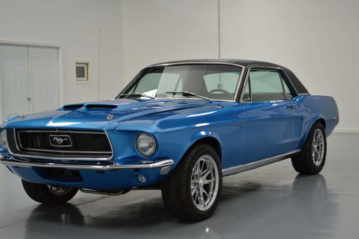 1968 Ford Mustang -- swap blue with green and this was my first car / but it wasn't built for Minnesota winters. :-)