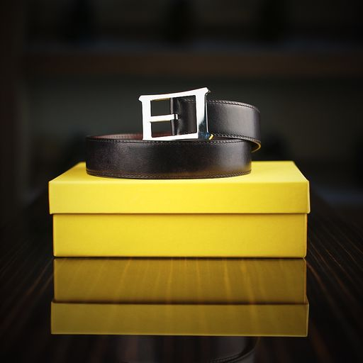 A 32mm-width reversible Museum Calf leather belt by John Lobb with a JL logo oblong buckle in polished nickel....