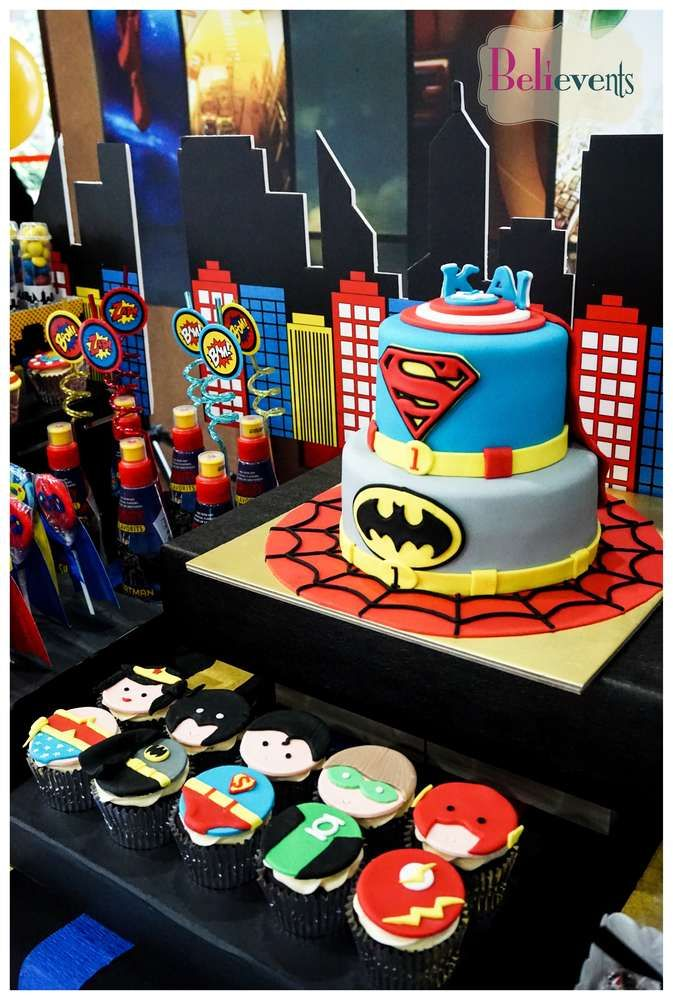 Awesome cake and cupcakes at a superhero birthday party! See more party ideas at CatchMyParty.com!