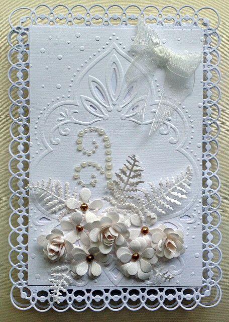 all in  white using  my favourite spellbinders frame.  www.delabur.co.uk