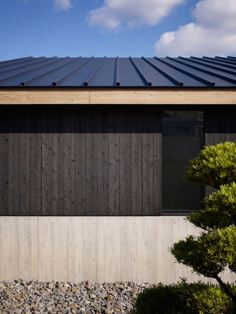 """Tokyo-based studio MDS used a traditional charring technique known as Yakisugi to blacken the cedar planks used for the building's exterior, helping to protect the building from decay."""