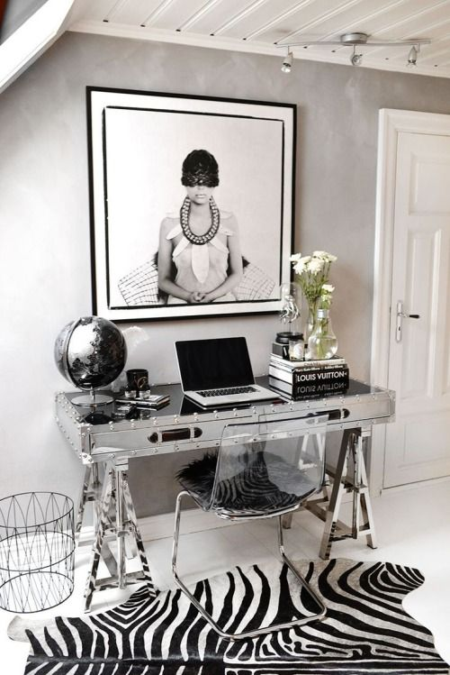 Home office envy: fashion/style blogger Annette Haga space is made streamlined and sophisticated with our Flight Desk, World Globe, and Faux Specimen.