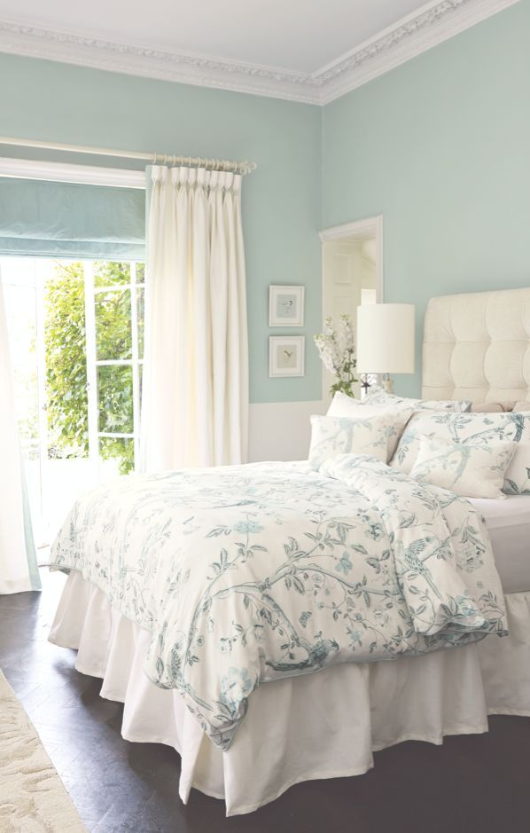 This light blue and white master bedroom's color palette and patterns feel so fresh for spring!