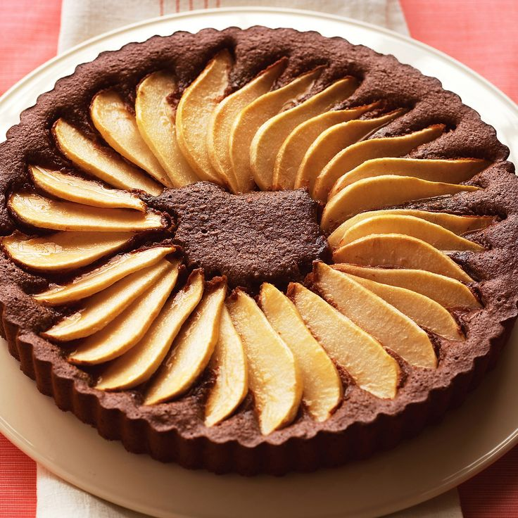 This luscious chocolate tart is topped with sliced pears.