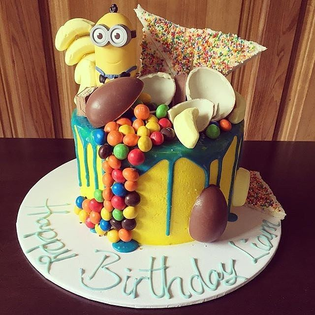 - Minions Themed, Chocolate Sponge Cake with Assorted Chocolate Kinder Treats and Blue Buttercream Drizzle on Top!  TAG a Cake Lover! - Cake by: @houseofbakes_