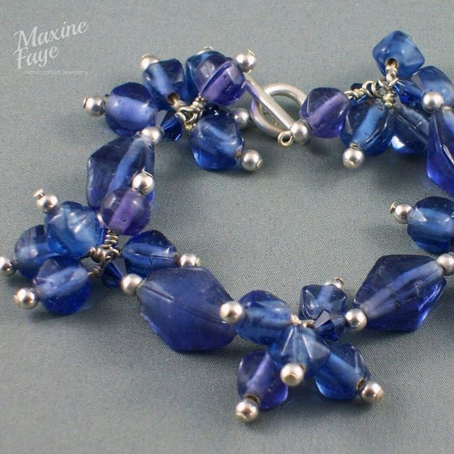Funky charm bracelet using handmade pressed glass, Crystals and round silver balls.  Finished with a toggle clasp.  This design is very versatile and can be made using many styles of beads and colours.    https://www.maxinefaye.com.au/product-category/bracelets/