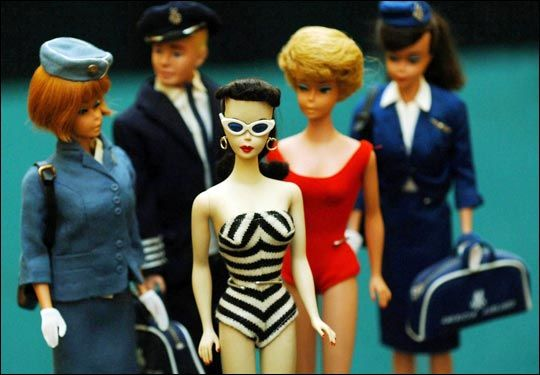 Nice flight crew... My Barbie was a stewardess, her outfit was on the far right. Oh! She had the zebra swimsuit too. Ken was the pilot.