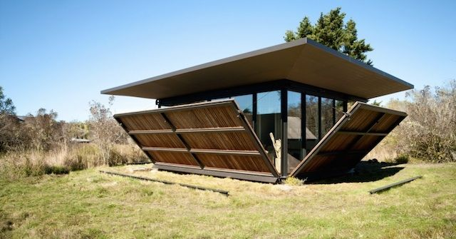 Shutters that fold out into a patio - False Bay Writer's Cabin (Olson Kundig Architects)