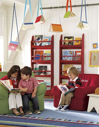 Books hanging from the ceiling is a great way to add pizzazz to the reading area. Reminds me of the Flying Books of Mr. Morris Lessmore;)