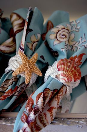 Beach decorating is all in the details.  Turks head knot napkins rings with sea shells. Perfect for beach themed weddings or bridal showers! #celebstylewed