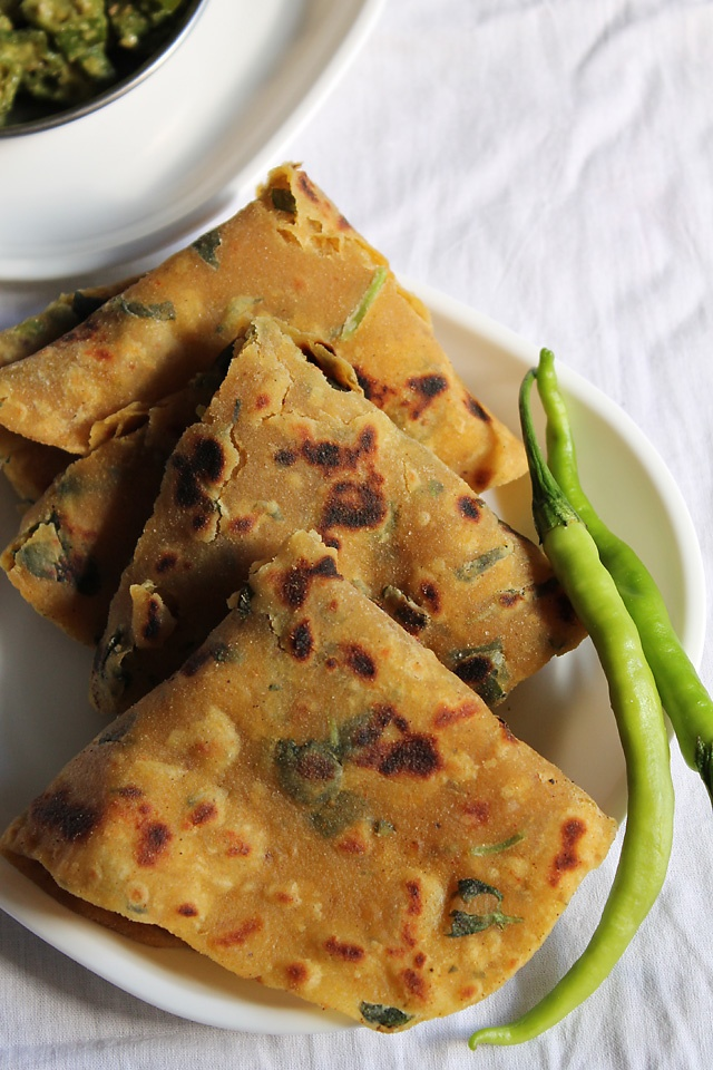 Gujarati Thepla-Gujarati Thepla is a flat Indian Bread made of whole wheat + Gram flour + some Indian spices + fenugreek leaves. Theplas reign from Gujarat and is their staple diet. Theplas are healthy and are great to carry in lunch boxes, while trekking, travelling Or eat at home.