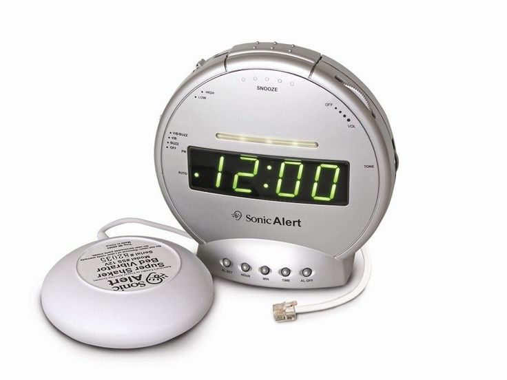 sonic boom vibrating alarm clock with telephone signaler clock telephone and sonic boom. Black Bedroom Furniture Sets. Home Design Ideas
