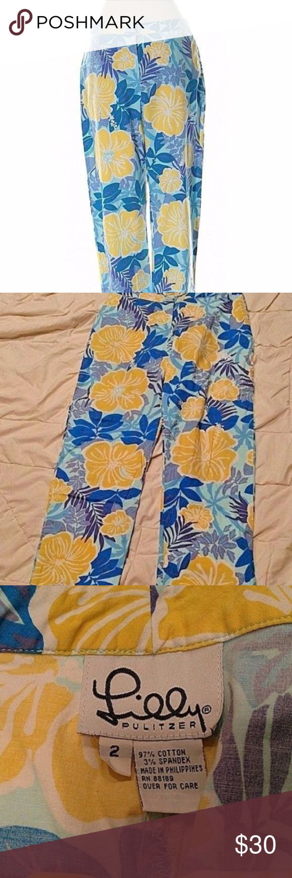 """Lilly Pulitzer Blue Yellow Floral Khaki Capris Lilly Pulitzer blue Capri pants with yellow flowers. Size 2. Cotton spandex blend. Gently used with no flaws.  Flat Lay Waist: 13"""" Rise: 9.5"""" Inseam: 24"""" Lilly Pulitzer Pants Capris"""