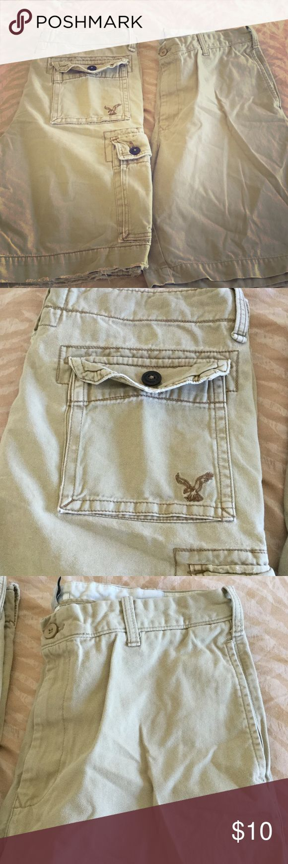 Men's khaki shorts bundle Size 34 good condition no holes.  One of the shorts is van heusen and that has no stains or holes. And the other is American eagle. That has a tiny stain on front american eagle Shorts