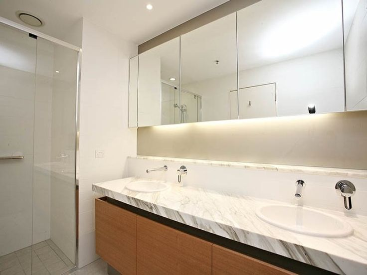 greys, whites, wood veneer cabinets, marble counter top, mirrored cabinets