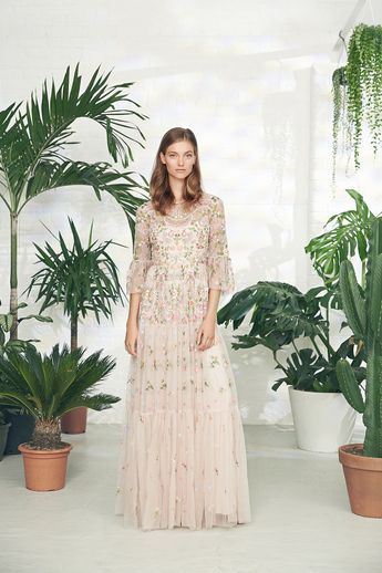 The Dragonfly Garden artwork is inspired by formal English gardens, with beautifully soft, delicate pastel florals and shimmering beaded dragonflies floating throughout. The gown silhouette is created in semi-sheer tulle with Victorian-style detailing in the form of fluted, voluminous sleeves and a full tiered skirt.