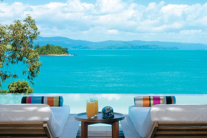 Relaxing by the pool at qualia, on Hamilton Island in the Whitsundays