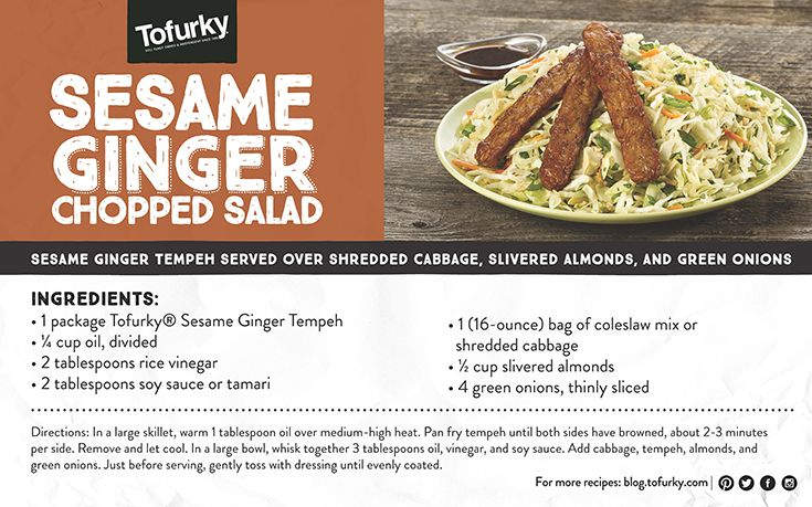 Sesame Garlic Tempeh served over shredded cabbage, slivered almonds, and green onions.