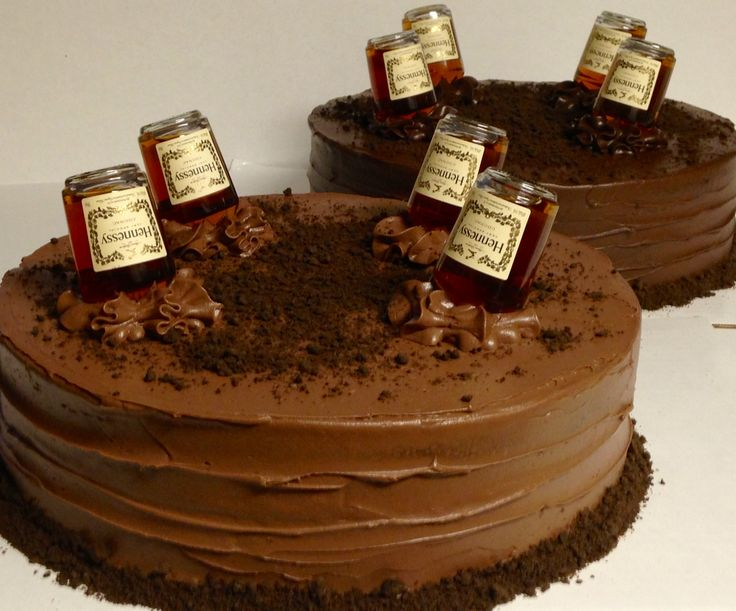 Yellow cake with Hennessy Chocolate Mousse filling...complete with real bottles of Hennessy sticking out of cakes!