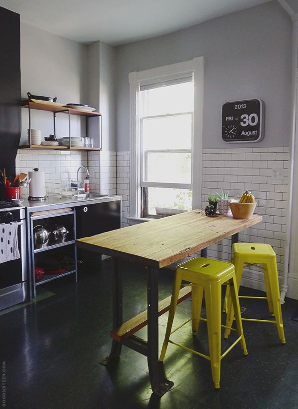 Gorgeous white tile industrial kitchen by door sixteen