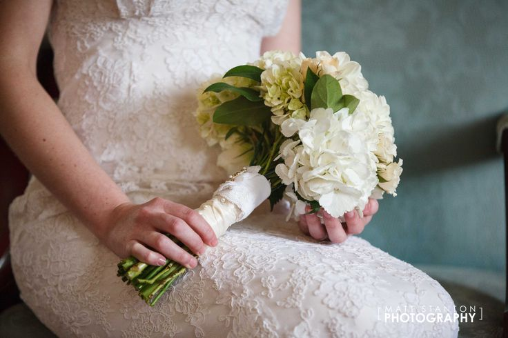 Bridal #bouquet full of white #hydrangea, white #dahlias, lizzianthus, and spray #roses