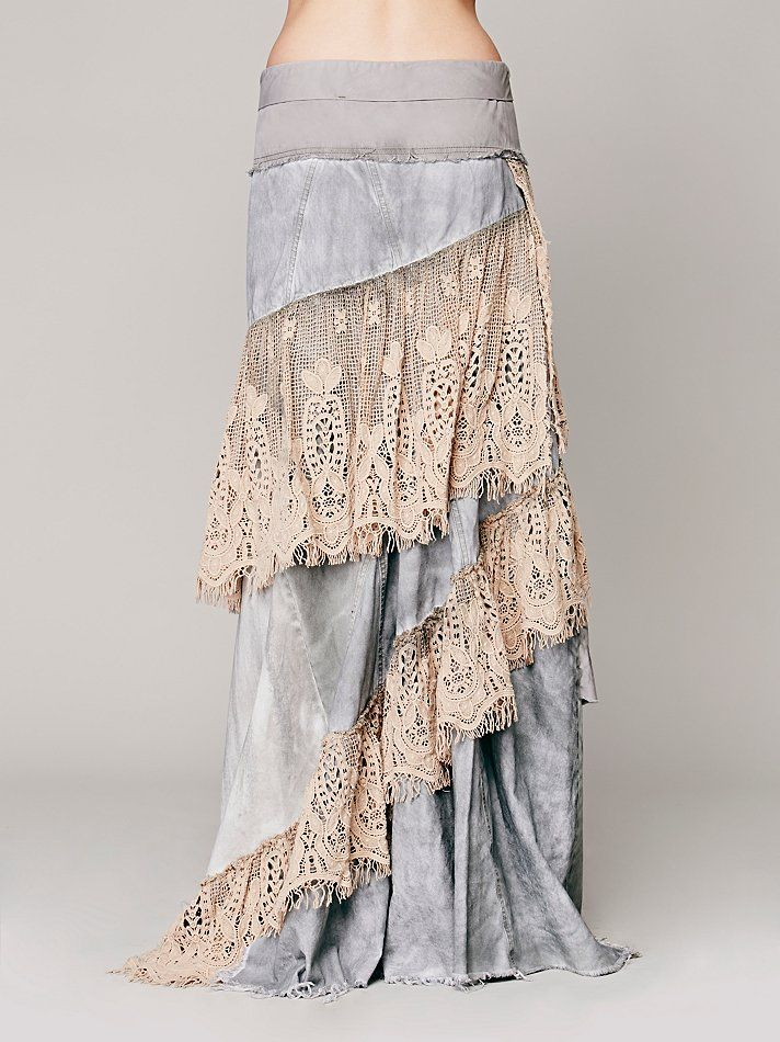 Abbie's Limited Edition Skirt   Distressed washed denim maxi skirt with intricate crochet overlay and crochet ruffle trimming. Crisscross wrap design in the front with button closure at front side of waist. Bottom hems are raw edge and gently frayed.