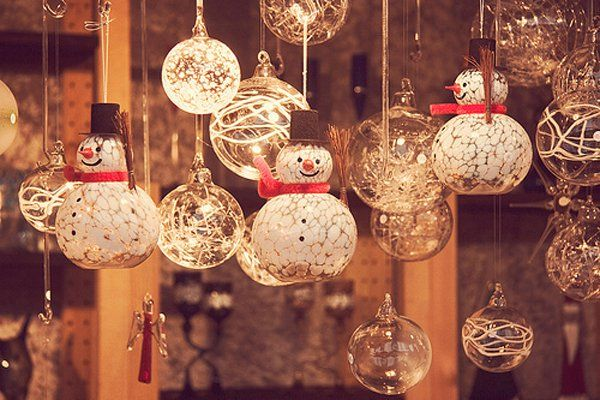 Glamorous snowman hanging ornaments. Let your wall décor shine and glint with crystal Christmas balls as well as snowman designed Christmas balls. It can surely make any room just as elegant.