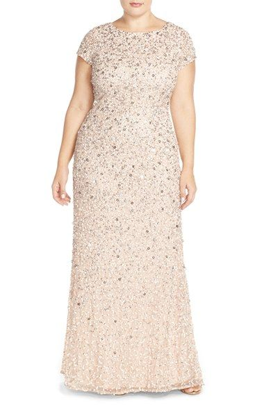 Embellished Scoop Back Gown (Plus Size) at Nordstrom.com. Swirls of metallic sequins and paillettes light up the short-sleeve bodice and cascading skirt of a lustrous mesh gown featuring a scooped back and floor-sweeping train for a lasting final impression.