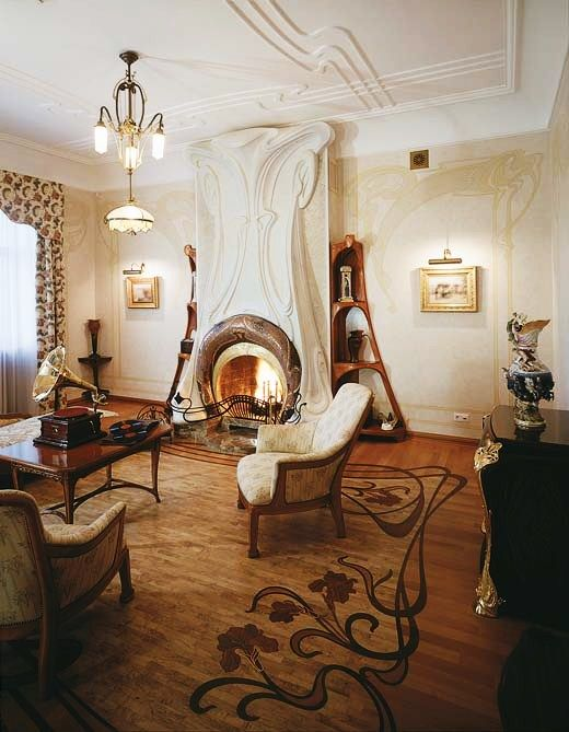The fireplace, floor design, bookshelf and ceiling designs all have the smooth flowing curves particular to the Art Nouveau style.
