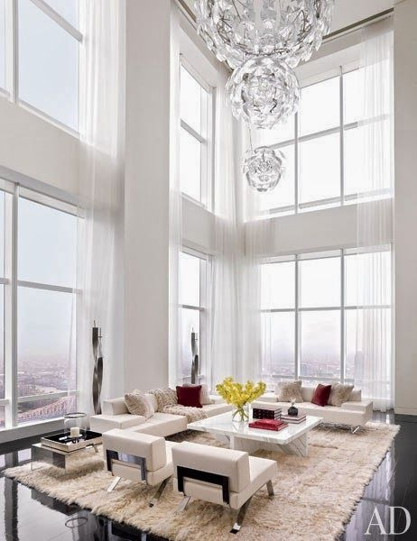 Created This Sleek Modern Apartment In New York City Complete With A Shimmering Luceplan USA Light Fixture Suspended The Double Height Living Room