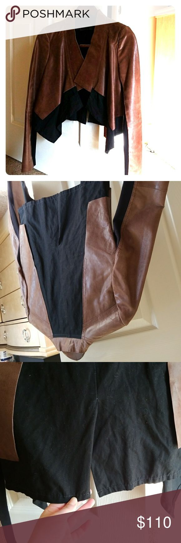"""BCBGMAXAZRIA brown and black lamb leather jacket This is a brown and black lamb leather jacket that I wore a handful of time. Please see posted tag to see that is 100% lamb leather on brown areas of jacket. Its a black material on the bottom. I was a size 4 with a larger bust when I wore this. I think you could easily size up or down with this. Has no stains, but has some natural wear but it was like that upon purchase, its part of """"the look"""" for the jacket. Small bend of material in pic…"""