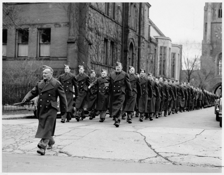 Conn Smythe leads his 30th Battery through the University of Toronto campus as he prepares for his second trip to war. Smythe, the legendary former owner of the Toronto Maple Leafs, fought with the famous Sportsmen Battery in WWI and, at age 45, formed the 30th Battery in Toronto. In this picture, they have marched through the famous Soldiers' Tower at the U of T.
