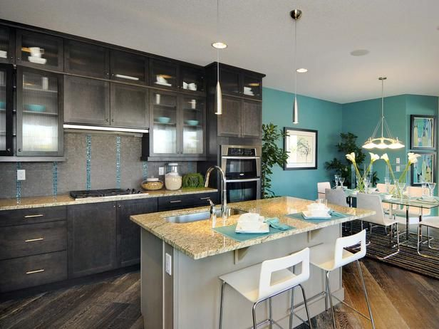 Bold Kitchen Area: The dining area relates to both the kitchen and living spaces.  From HGTVRemodels.com