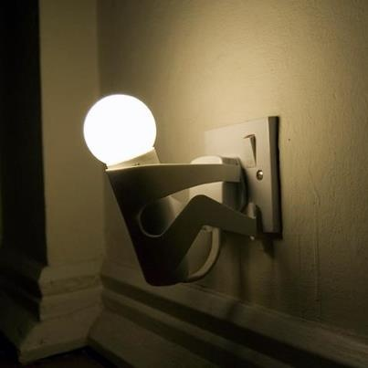 Martyr lamp looks like a little man who is trying to take the cable out of