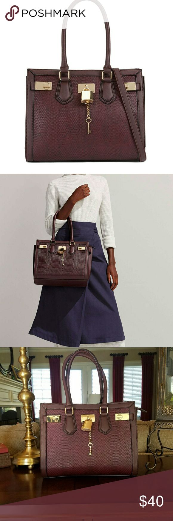 Aldo Gilliam burgundy purse (NEW) Material: Synthetic  Sleek gold metal accents shine against the tonal textured finish of this perfectly sized shoulder bag. - Shoulder bag. - Top zipper closure. - Decorative metal ornament.  - Double handle. - Width: 13 in. - Depth: 6.3 in. - Height: 9.1 in. Aldo Bags Shoulder Bags