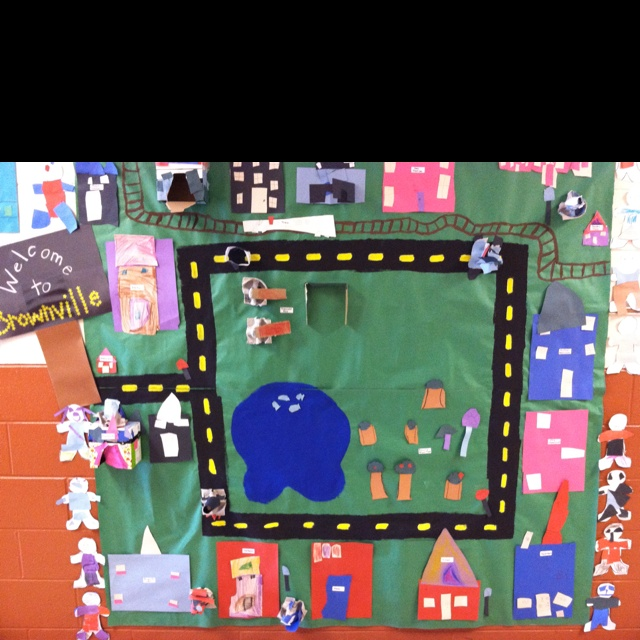 """Kindergarten community helpers bulletin board. All the students were assigned a community helper and were in charge of """"building"""" the place where that helper lives!"""