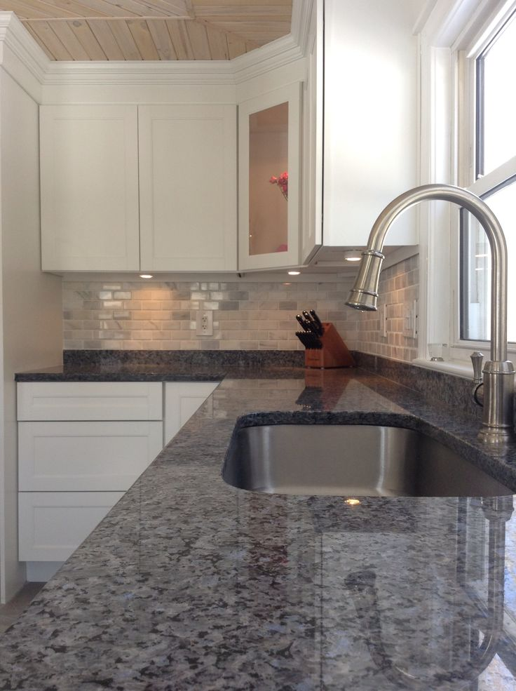 our renovated kitchen is done blue pearl counters artisan faucet white marble