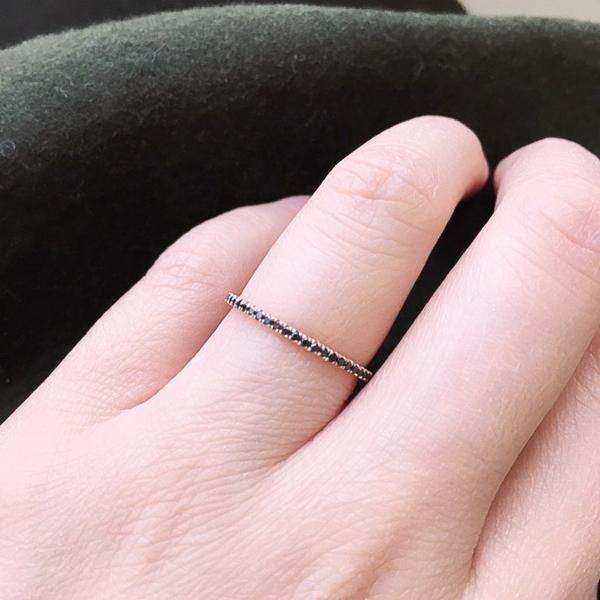 This 14k gold thin eternity band features hand set micro pave diamonds. SKU: R01002794