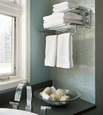 Steal this idea from your favorite hotel: install a towel rack above the bathtub or next to a sink so they're easy to grab when needed.