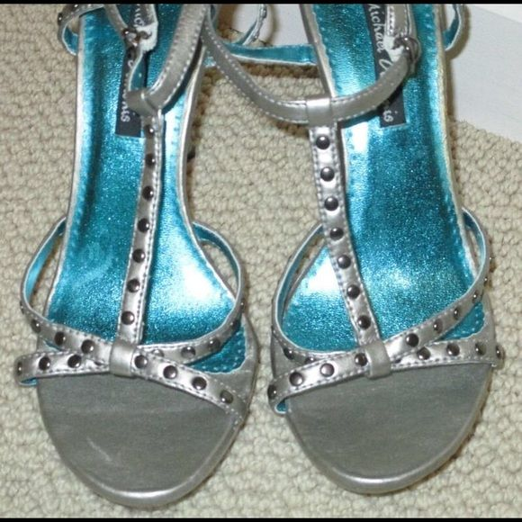 Michael Antonio Silver Strappy Sandals Heels 6.5 Michael Antonio Metallic Silver with Gunmetal Studs Strappy Sandal Heels Heel Measures Approx 4' Size 6.5 Wore a few times Great Condition.  I have a smoke -free pet -free home. Michael Antonio Shoes Heels