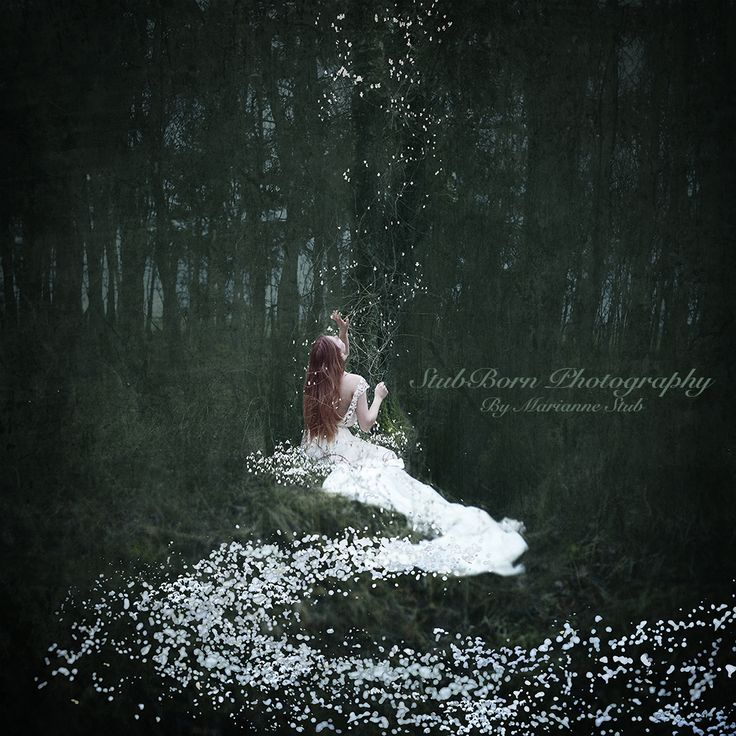 Fineart photohraphy by Danish photographer, Marianne Stub. Selfportrait in the woods surrounded by snowdrops