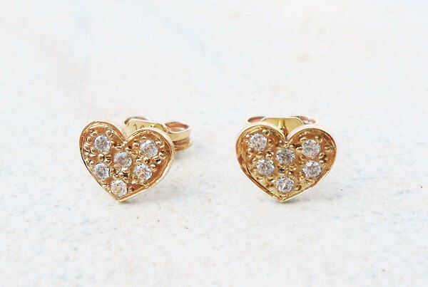 A personal favourite from my Etsy shop https://www.etsy.com/listing/453945802/gold-heart-studs-14kt-solid-gold-heart