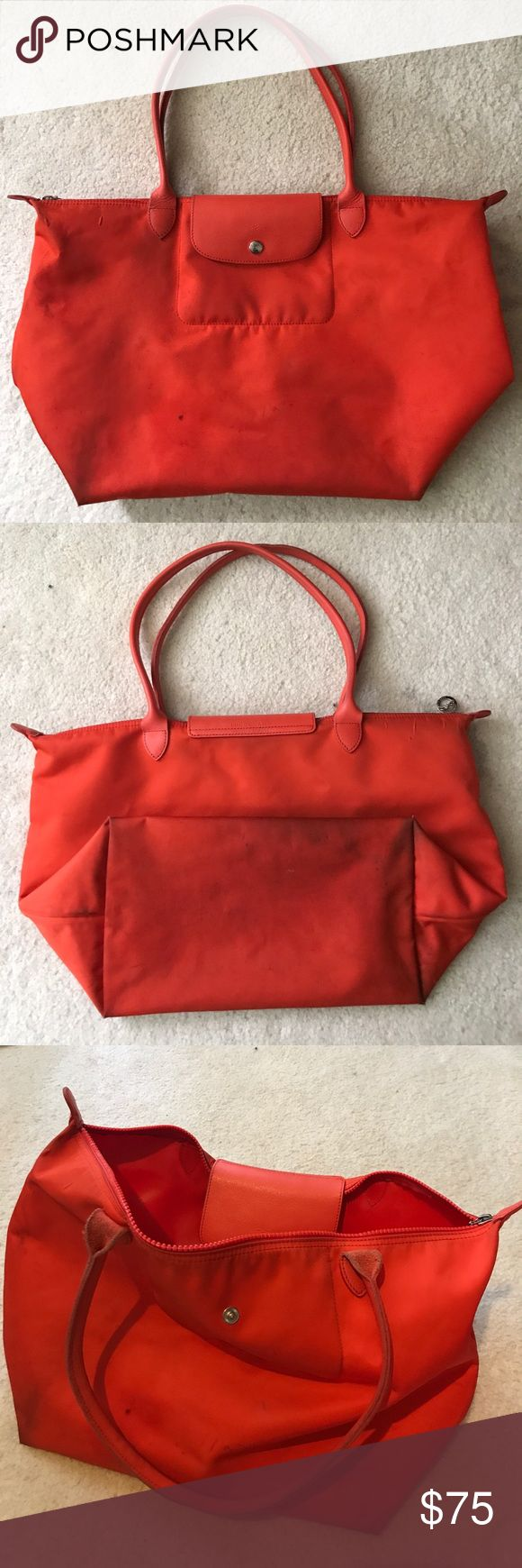 Longchamp Large Le Pliage Neo Nylon Tote Orange Beautiful vibrant orange color, very well used. Majority of the staining is at the back and under the bag. The handles have softened to a comfortable leather. Longchamp Bags Shoulder Bags