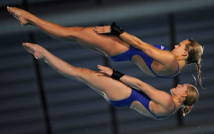 Tonia Couch and Sarah Barrow of Great Britain compete during the women's 10m platform synchro diving preliminary of the 31st LEN European Swimming Championships in Eindhoven, Netherlands