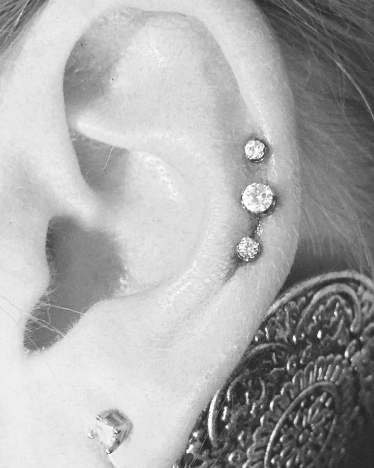 Triple cartilage piercing by Brittany  INK INK Springfield, MO l