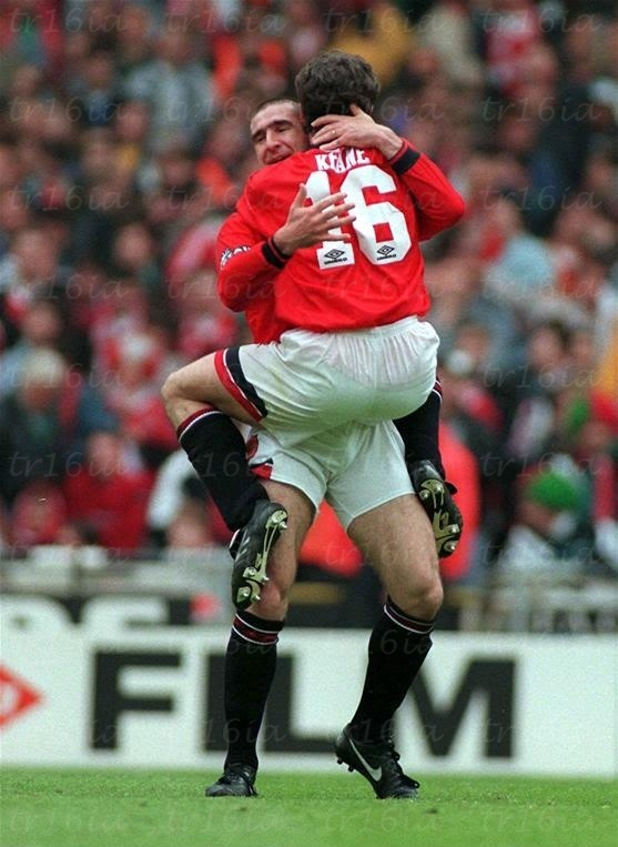 May 11 1996, Wembley, FA Cup Final.  Roy Keane leaps on Eric Cantona after he scores Manchester United's goal to defeat Liverpool 1-0