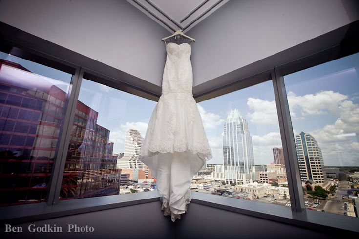 Wedding dress hanging in the window at the W hotel in downtown Austin