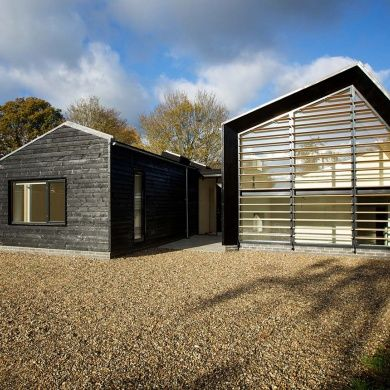 Bourne Lane House: Location: Tonbridge, England Year of Construction: 2014 Architects: Nash Baker Architects  Two Barn-like structures cladded with blackened timber and wood louvers to control the natural light in certain areas.